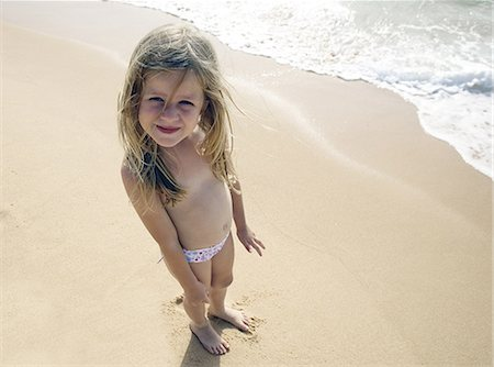 Girl posing for camera on beach Stock Photo - Premium Royalty-Free, Code: 649-07118154
