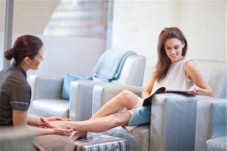 foot massage - Woman having feet massaged in spa treatment room Stock Photo - Premium Royalty-Free, Code: 649-07118214