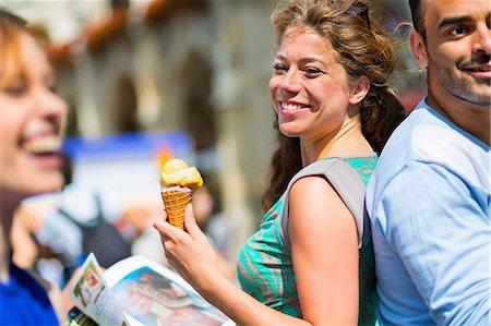 eating ice cream - Woman eating ice cream, smiling Stock Photo - Premium Royalty-Free, Code: 649-07118233