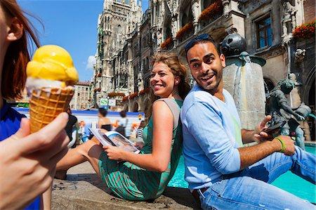 europe - Couple and woman with ice cream, Munich Marienplatz, Munich, Germany Stock Photo - Premium Royalty-Free, Code: 649-07118251