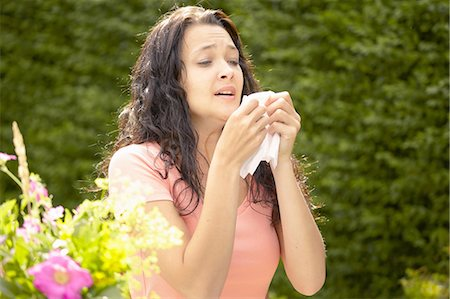 people coughing or sneezing - Girl about to sneeze into tissue Stock Photo - Premium Royalty-Free, Code: 649-07118284