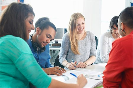 Group of college students studying together Stock Photo - Premium Royalty-Free, Code: 649-07118408