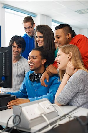 Group of college students using computer Stock Photo - Premium Royalty-Free, Code: 649-07118410