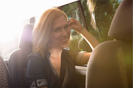 road trip - Young woman travelling in back seat of car Stock Photo - Premium Royalty-Free, Code: 649-07118472