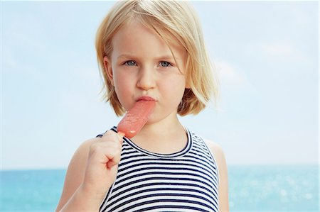 Child eating ice lolly Stock Photo - Premium Royalty-Free, Code: 649-07118487