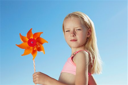 Girl holding toy windmill Stock Photo - Premium Royalty-Free, Code: 649-07118500