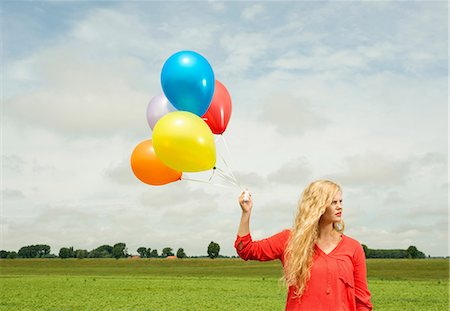 Woman with balloons Stock Photo - Premium Royalty-Free, Code: 649-07118511