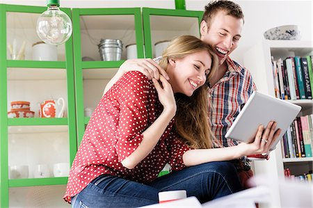 Couple on video chat using digital tablet Stock Photo - Premium Royalty-Free, Code: 649-07118545