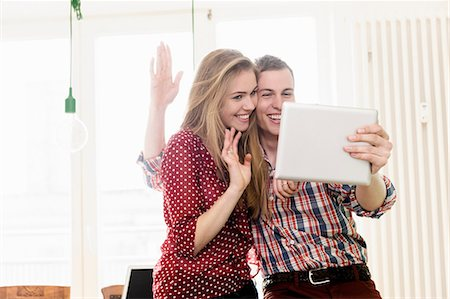 Couple on video chat using digital tablet Stock Photo - Premium Royalty-Free, Code: 649-07118540
