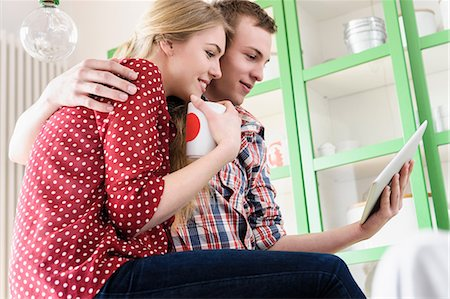 Couple on video chat using digital tablet Stock Photo - Premium Royalty-Free, Code: 649-07118543