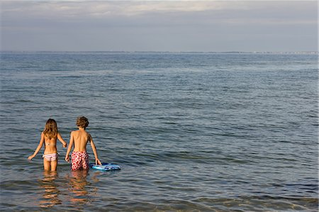 Brother and sister paddling in sea Stock Photo - Premium Royalty-Free, Code: 649-07118654