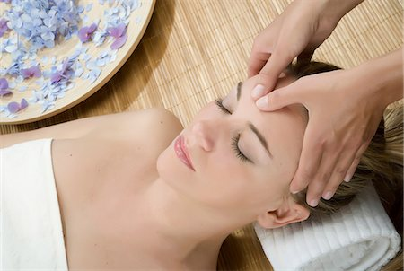 smelling - Woman at spa having forehead massaged Stock Photo - Premium Royalty-Free, Code: 649-07118665