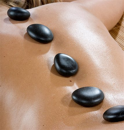 Hot stones on woman's back Stock Photo - Premium Royalty-Free, Code: 649-07118686