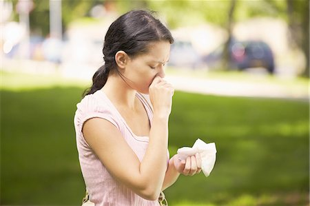 people coughing or sneezing - Woman suffering from hay fever Stock Photo - Premium Royalty-Free, Code: 649-07118716