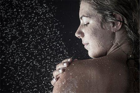 shower - Woman showering Stock Photo - Premium Royalty-Free, Code: 649-07118724