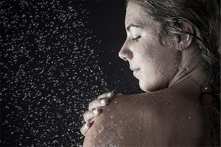 Woman showering Stock Photo - Premium Royalty-Free, Code: 649-07118724