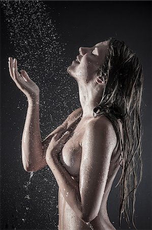 Woman showering Stock Photo - Premium Royalty-Free, Code: 649-07118725
