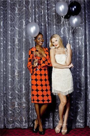 Portrait of two young women holding balloons Stock Photo - Premium Royalty-Free, Code: 649-07118867
