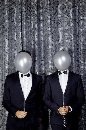 party - Portrait of two young men with balloons in front of faces Stock Photo - Premium Royalty-Free, Code: 649-07118874