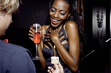 flirting - Young woman getting birthday cake in nightclub Stock Photo - Premium Royalty-Free, Code: 649-07118907