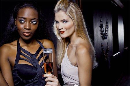 Two female friends watching in nightclub Stock Photo - Premium Royalty-Free, Code: 649-07118901