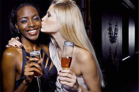 Two female friends hugging in nightclub Stock Photo - Premium Royalty-Free, Code: 649-07118902