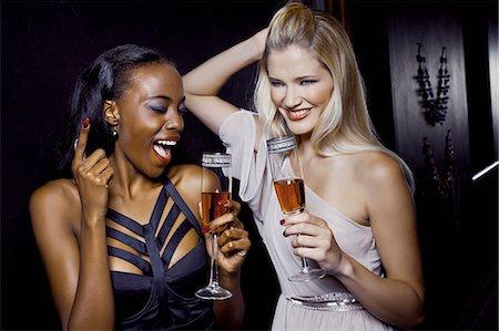 Two female friends having fun in nightclub Stock Photo - Premium Royalty-Free, Code: 649-07118903