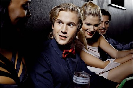 Young men and women sitting together in nightclub Stock Photo - Premium Royalty-Free, Code: 649-07118912