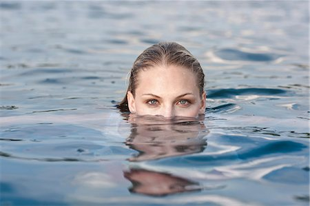 Portrait of young woman submerged in lake Stock Photo - Premium Royalty-Free, Code: 649-07119046