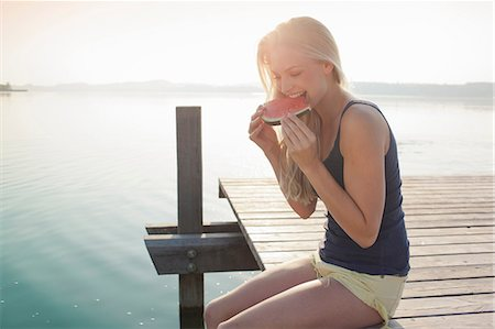 Portrait of young woman eating watermelon Stock Photo - Premium Royalty-Free, Code: 649-07119050