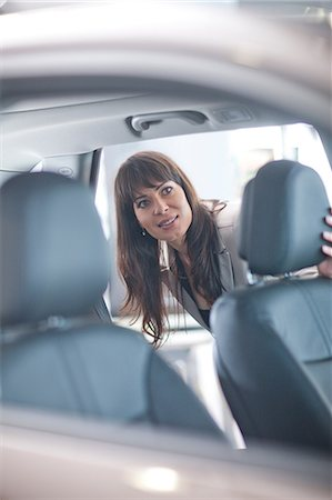 Mid adult woman checking car seat in showroom Stock Photo - Premium Royalty-Free, Code: 649-07119126