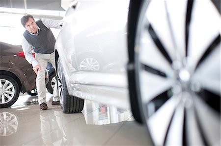 shiny - Mid adult man checking car in showroom Stock Photo - Premium Royalty-Free, Code: 649-07119137