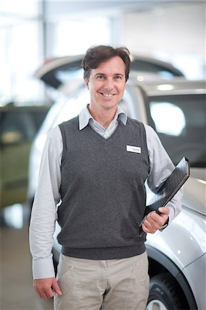 shiny - Car salesman with file in showroom Stock Photo - Premium Royalty-Free, Code: 649-07119157