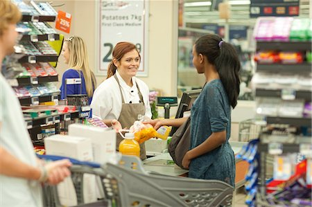Female shop assistant at check-out Stock Photo - Premium Royalty-Free, Code: 649-07119189