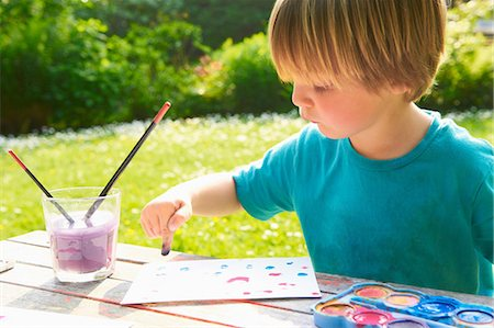 finger painting - Young boy finger painting in garden Stock Photo - Premium Royalty-Free, Code: 649-07119206