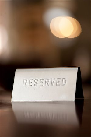 Reserved notice on restaurant table Stock Photo - Premium Royalty-Free, Code: 649-07119264