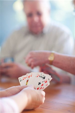 Senior male playing cards with family Stock Photo - Premium Royalty-Free, Code: 649-07119277