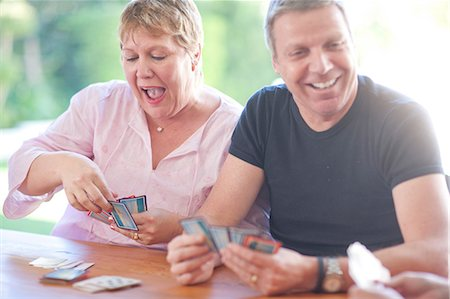 Mature male playing cards with sister Stock Photo - Premium Royalty-Free, Code: 649-07119279