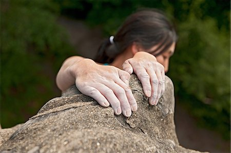 Woman hanging on to sandstone Stock Photo - Premium Royalty-Free, Code: 649-07119333