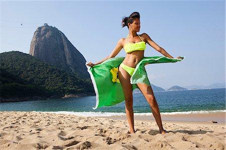 sexi women full body - Man standing on beach with Brazilian flag, Rio de Janeiro, Brazil Stock Photo - Premium Royalty-Free, Code: 649-07119369