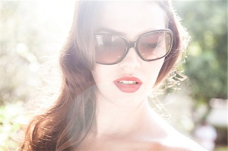 dark glasses - Young woman wearing sunglasses Stock Photo - Premium Royalty-Free, Code: 649-07119495