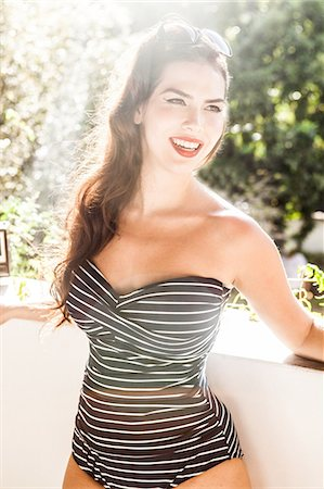 Young woman wearing striped swimsuit Stock Photo - Premium Royalty-Free, Code: 649-07119496