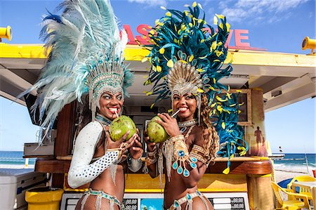 Two samba dancers drinking coconut drinks, Ipanema Beach, Rio, Brazil Stock Photo - Premium Royalty-Free, Code: 649-07119506