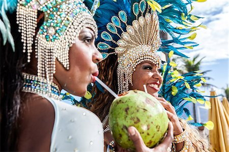 Samba dancers in costume, drinking coconut drinks, Ipanema Beach, Rio De Janeiro, Brazil Stock Photo - Premium Royalty-Free, Code: 649-07119507