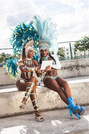 Samba dancers in costume, using digital tablet, Rio De Janeiro, Brazil Stock Photo - Premium Royalty-Free, Code: 649-07119515