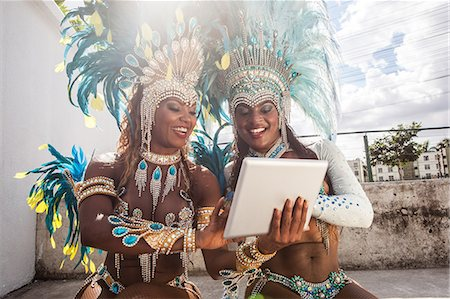 Samba dancers in costume, using digital tablet, Rio De Janeiro, Brazil Stock Photo - Premium Royalty-Free, Code: 649-07119516