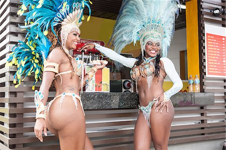 Samba dancers in costume by food stall, Rio De Janeiro, Brazil Stock Photo - Premium Royalty-Free, Code: 649-07119517