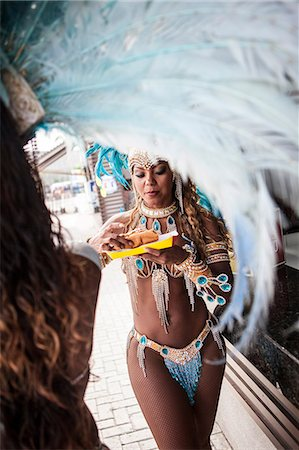 Samba dancers having hot dogs, Rio De Janeiro, Brazil Stock Photo - Premium Royalty-Free, Code: 649-07119519