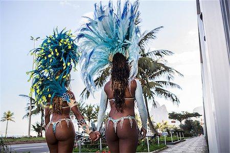 Rear view of samba dancers holding hands, Ipanema Beach, Rio De Janeiro, Brazil Stock Photo - Premium Royalty-Free, Code: 649-07119512