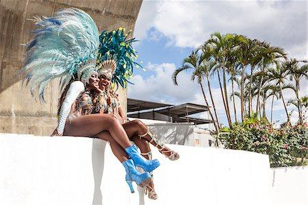 Samba dancers sitting on wall, Rio de Janeiro, Brazil Stock Photo - Premium Royalty-Free, Code: 649-07119524